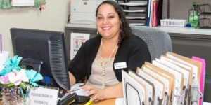 Marlen Smiling at Desk